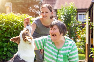 woman with a nurse and a companion dog